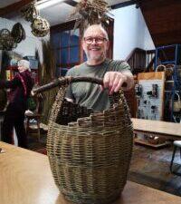 man-with-log-basket